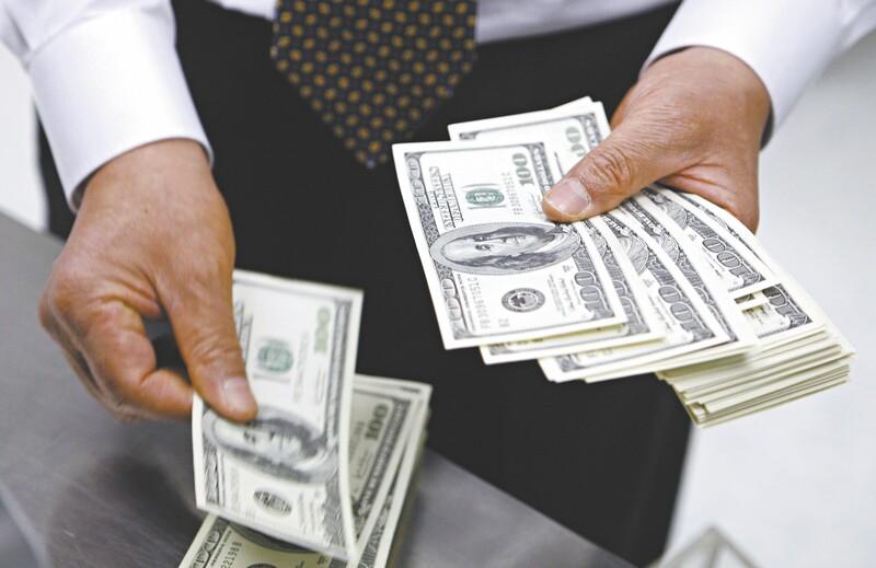 Fed mantém juros e anuncia retirada de estímulos